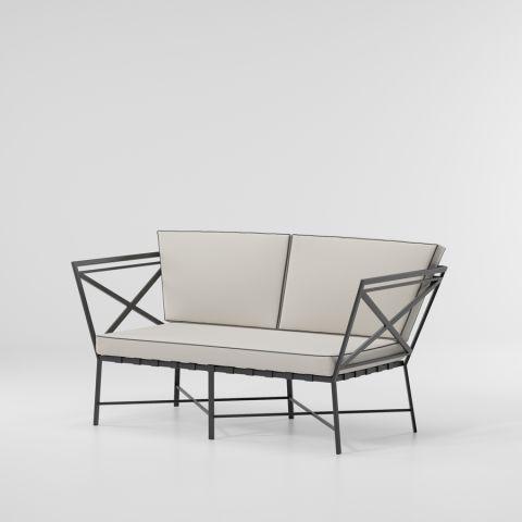 1950_2_seater_sofa_crossed_arms.jpg